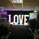 Black LED Curtain Backdrop With Illuminated LOVE Letters